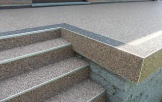 Steinteppich-Verlegung